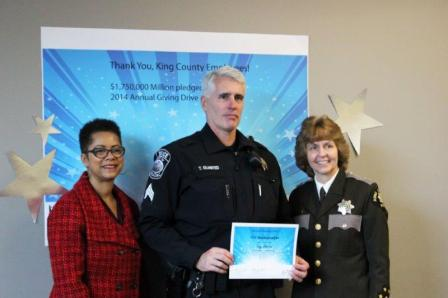 Captain Troy Olmsted from the Sheriff's Office being recognized for Outstanding Ambassadorship.