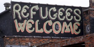 'Refugees Welcome' is seen painted on a building near downtown Detroit.